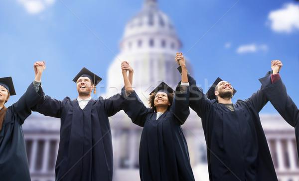 happy students or bachelors celebrating graduation Stock photo © dolgachov