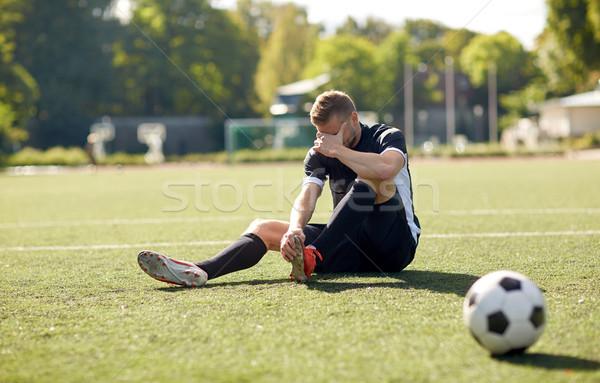Ranny piłkarz piłka boisko do piłki nożnej sportu piłka nożna Zdjęcia stock © dolgachov