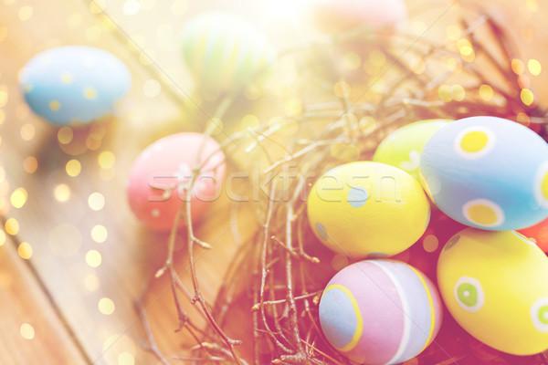 Közelkép színes húsvéti tojások fészek fa húsvét Stock fotó © dolgachov