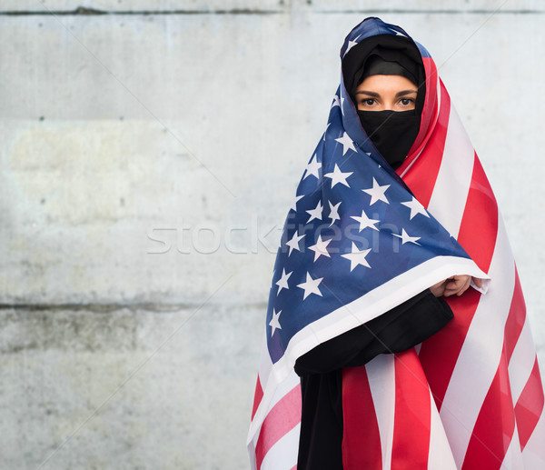 muslim woman in hijab with american flag Stock photo © dolgachov