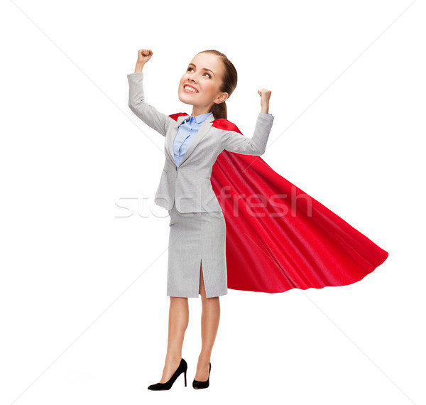 young smiling businesswoman in red superhero cape Stock photo © dolgachov