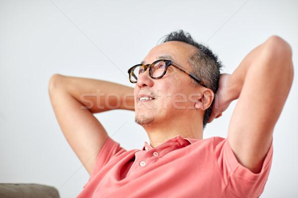 Mann Gläser entspannenden träumen home entspannen Stock foto © dolgachov