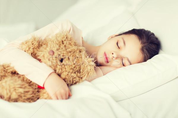Kız uyku oyuncak ayı oyuncak yatak ev Stok fotoğraf © dolgachov