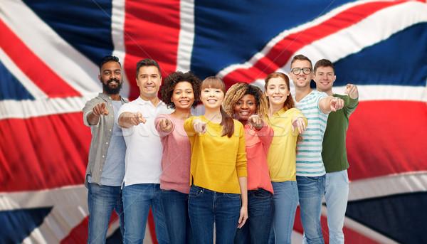 Internationale groep mensen wijzend diversiteit immigratie mensen Stockfoto © dolgachov