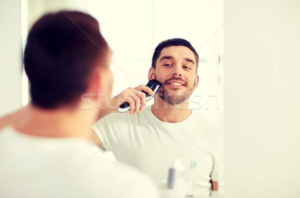 Homme barbe salle de bain beauté hygiène Photo stock © dolgachov
