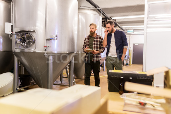 Stock photo: men working at craft brewery or beer plant