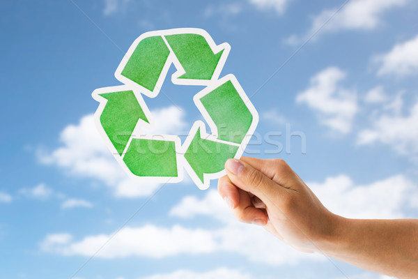close up of hand with green recycle sign over sky Stock photo © dolgachov