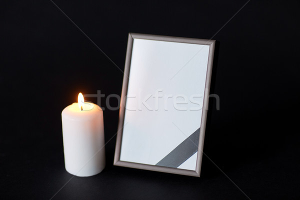 black ribbon on photo frame and candle at funeral Stock photo © dolgachov