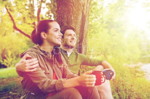счастливым пару питьевой природы путешествия Сток-фото © dolgachov
