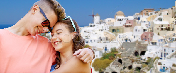 Boldog tini pár ölel Santorini sziget Stock fotó © dolgachov