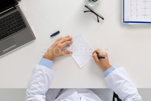 doctor hands with prescription at clinic Stock photo © dolgachov