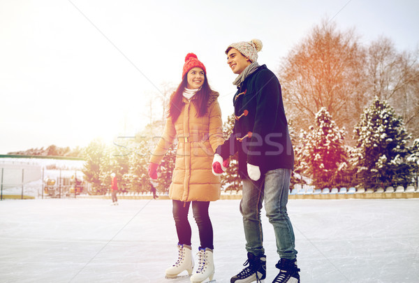 happy couple ice skating on rink outdoors Stock photo © dolgachov