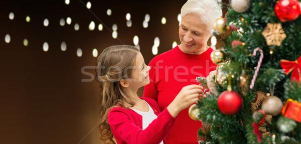 happy family decorating christmas tree Stock photo © dolgachov