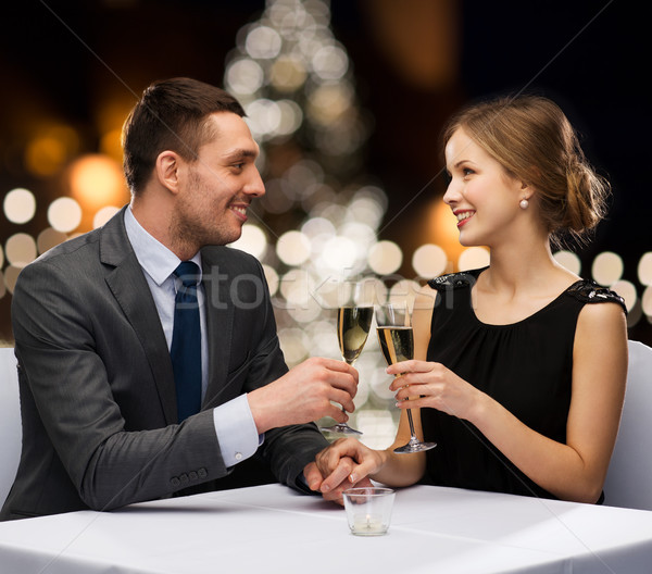couple with non alcoholic champagne at christmas Stock photo © dolgachov