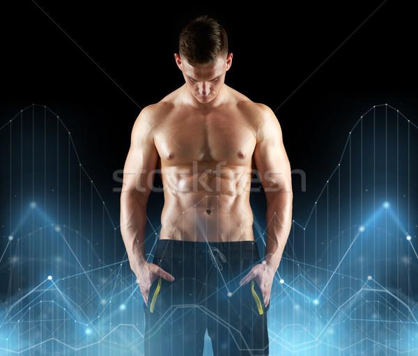 young man or bodybuilder with bare torso Stock photo © dolgachov