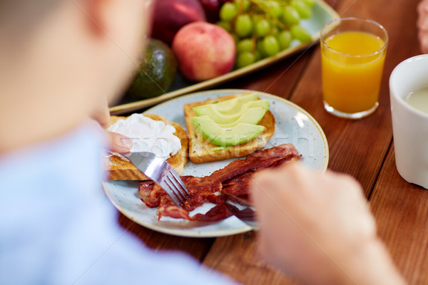 человека еды тоста моцарелла яйцо бекон Сток-фото © dolgachov