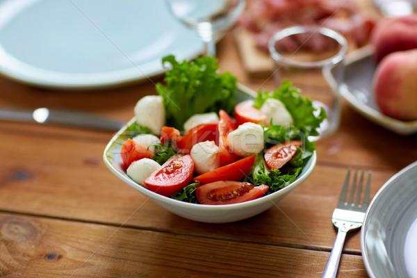 vegetable salad with mozzarella on wooden table Stock photo © dolgachov