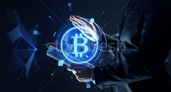 businessman with tablet pc and bitcoin hologram Stock photo © dolgachov