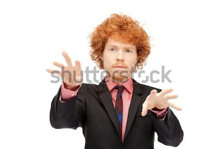 üzletember dolgozik valami képzeletbeli kép üzlet Stock fotó © dolgachov