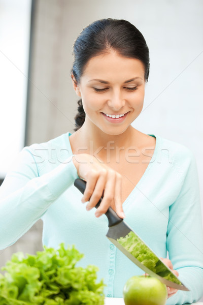 beautiful woman in the kitchen Stock photo © dolgachov