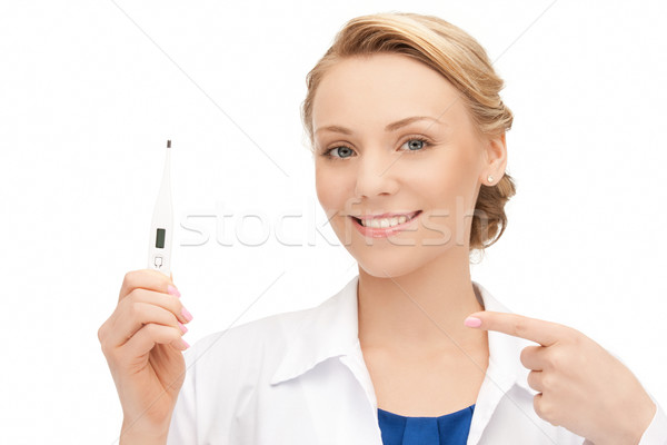 attractive female doctor with thermometer Stock photo © dolgachov