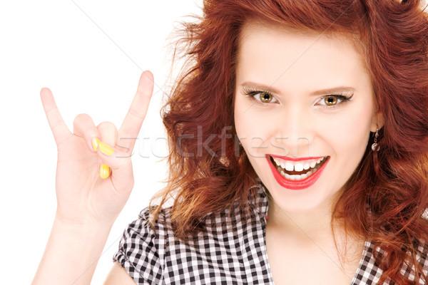 happy teenage girl showing devil horns gesture Stock photo © dolgachov