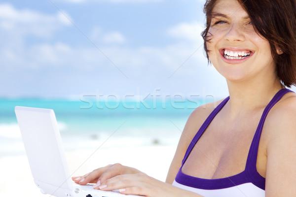 woman with laptop computer on the beach Stock photo © dolgachov