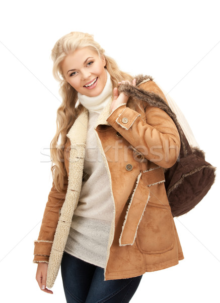 woman in sheepskin jacket Stock photo © dolgachov