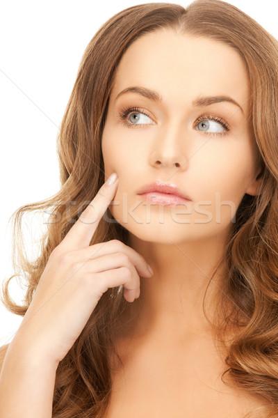 Bela mulher indicação bochecha brilhante quadro mulher Foto stock © dolgachov