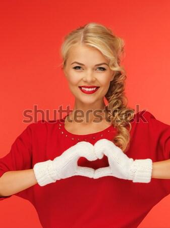 Donna muffole vestito rosso fiocco di neve foto donne Foto d'archivio © dolgachov