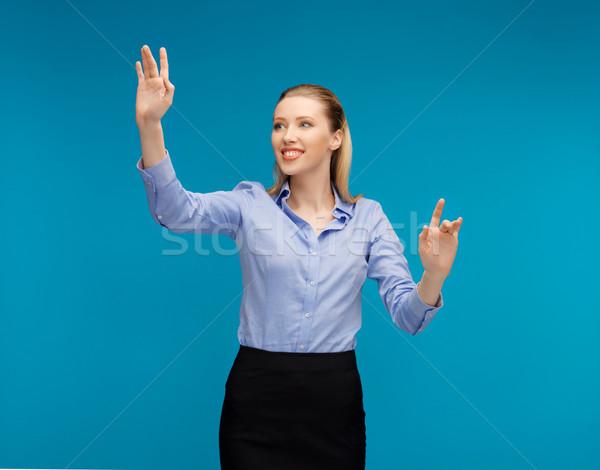 Femme travail quelque chose imaginaire lumineuses photos Photo stock © dolgachov