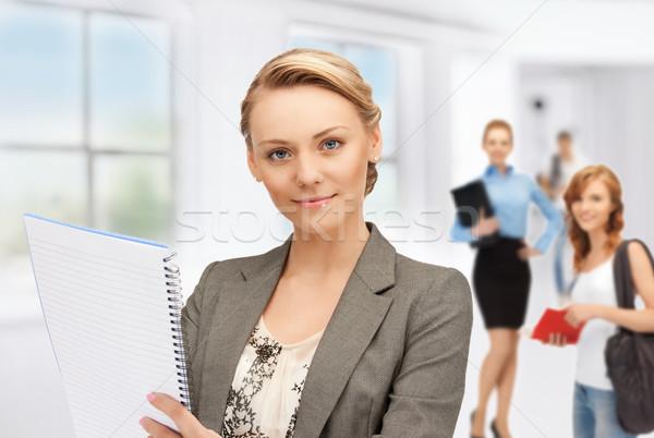 Leraar studenten foto notebook vrouw papier Stockfoto © dolgachov