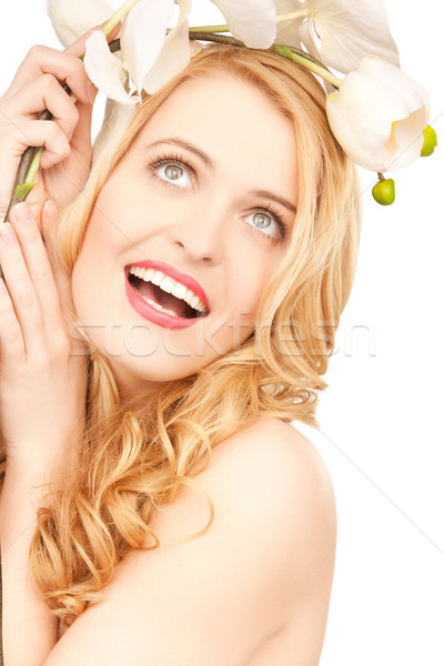 Stock photo: smiling woman with orchid flower