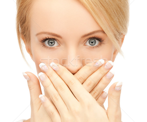 amazed woman with hand over mouth Stock photo © dolgachov