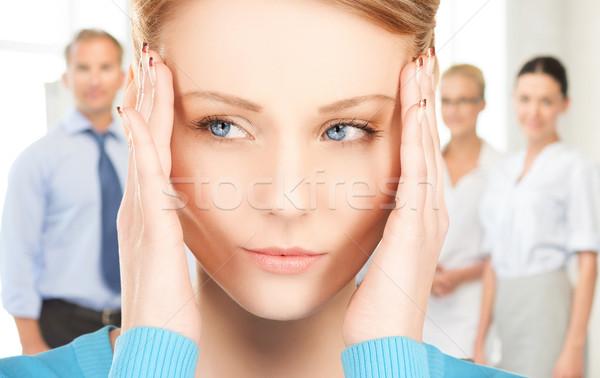 Boldogtalan nő tart fej kezek munka Stock fotó © dolgachov