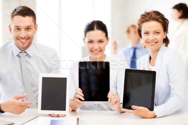 business team showing tablet pcs in office Stock photo © dolgachov