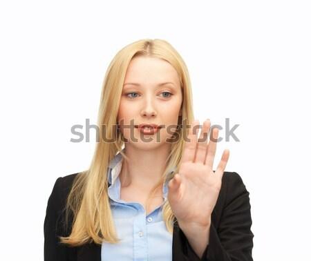 деловая женщина рабочих что-то мнимый красивой молодые Сток-фото © dolgachov