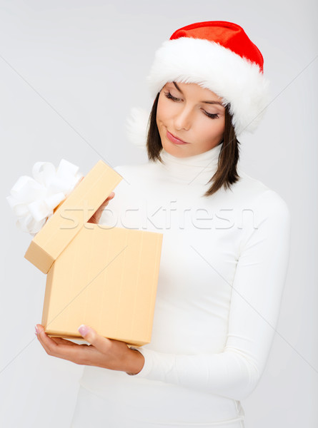suspicious woman in santa helper hat with gift box Stock photo © dolgachov