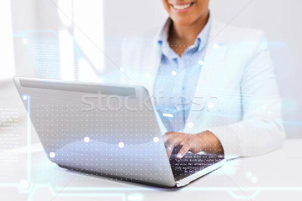 businesswoman using her laptop computer Stock photo © dolgachov