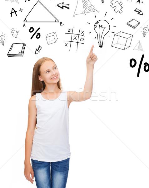 girl in white shirt pointing to idea Stock photo © dolgachov