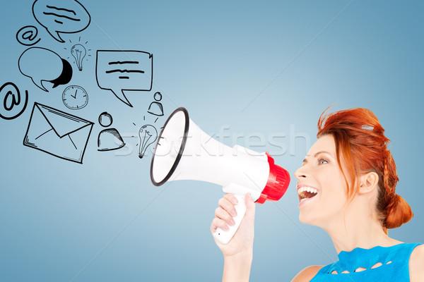 woman with megaphone Stock photo © dolgachov