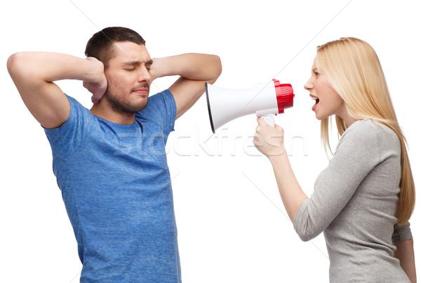 girlfriend screaming though megaphone at boyfriend Stock photo © dolgachov