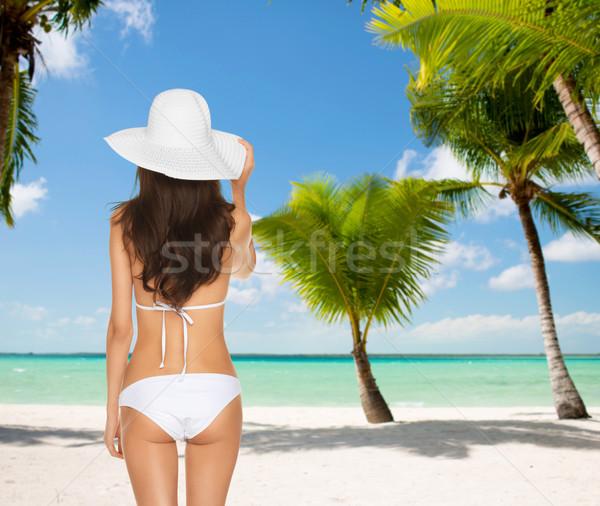 woman posing in white bikini Stock photo © dolgachov
