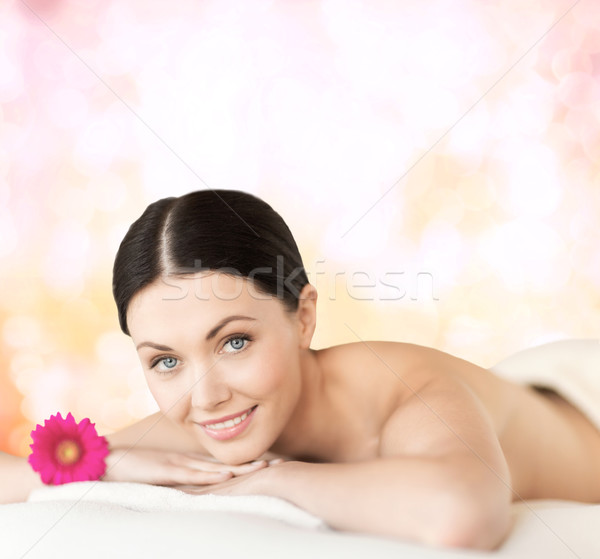 smiling woman lying on the massage desk Stock photo © dolgachov