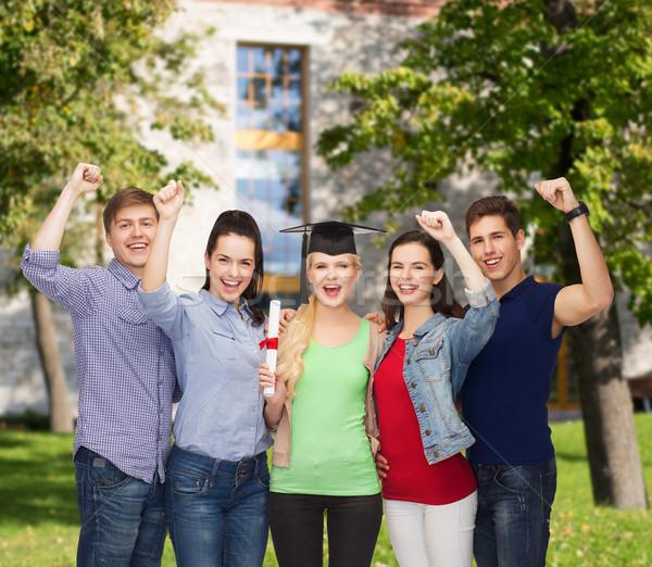 Csoport áll mosolyog diákok diploma oktatás Stock fotó © dolgachov