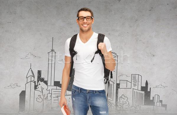 Mosolyog diák hátizsák könyv oktatás utazás Stock fotó © dolgachov