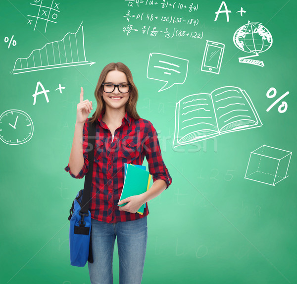 smiling student girl showing thumbs up Stock photo © dolgachov