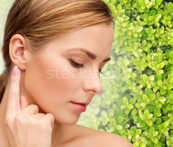 beautiful young woman touching her ear Stock photo © dolgachov