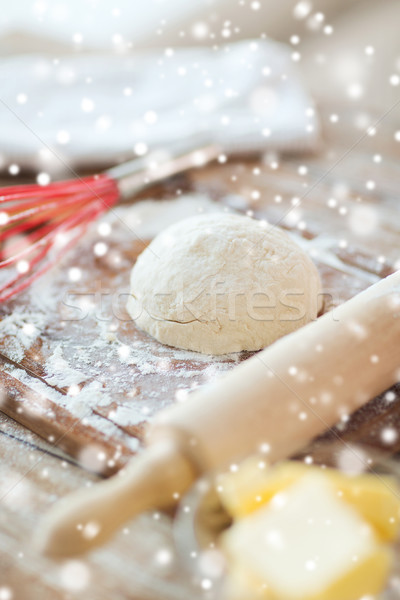 Stock photo: close up of dough and utensils on cutting board