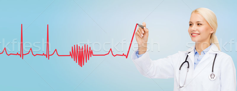 Souriant Homme médecin dessin pulsation cardiogramme Photo stock © dolgachov